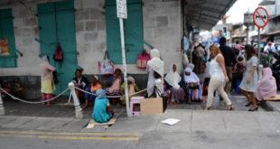 Des mendiants à proximité de la Jummah Masjid...